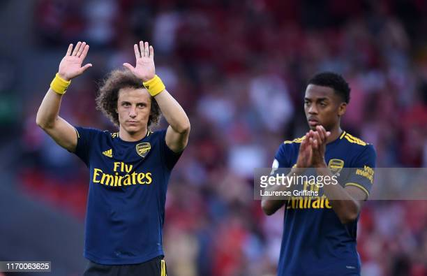 David Luiz and Matteo Guendouzi of Arsenal applaud the fans following their sides defeatduring the Premier League match between Liverpool FC and...