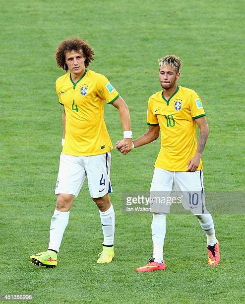 David Luiz and Neymar of Brazil celebrate after defeating Chile in a penalty shootout during the 2014 FIFA World Cup Brazil round of 16 match between...