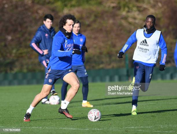 David Luiz and Nicolas Pepe of Arsenal during a training session at London Colney on January 22, 2021 in St Albans, England.