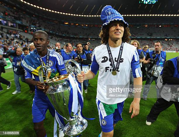 David Luiz and Ramires of Chelsea celebrate with the trophy after their victory in the UEFA Champions League Final between FC Bayern Muenchen and...