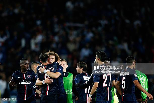 David Luiz and Thiago Motta of PSG embrace as they celebrate victory in the Group F UEFA Champions League match between Paris SaintGermain v FC...