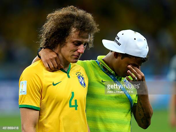 David Luiz and Thiago Silva of Brazil show their dejection after the 17 defeat in the 2014 FIFA World Cup Brazil Semi Final match between Brazil and...
