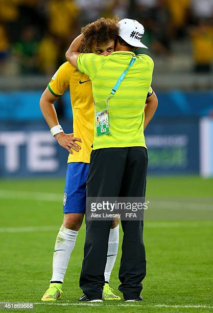 David Luiz and Thiago Silva of Brazil show their dejection after the 1-7 defeat in the 2014 FIFA World Cup Brazil Semi Final match between Brazil and...