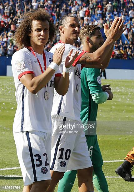 David Luiz and Zlatan Ibrahimovic of PSG greet their fans after winning the 2015 Trophee des Champions between Paris SaintGermain and Olympique...
