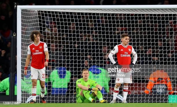 David Luiz Bernd Leno and Lucas Torreira of Arsenal FC look dejected after their side concede their second goal during the UEFA Europa League round...