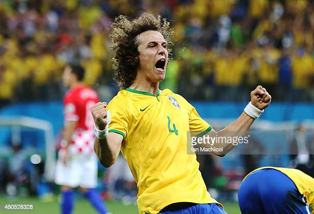 David Luiz celebrates Oscars goal during the opening match of the 2014 World Cup between Brazil and Croatia at Arena de Sao Paulo on June 12 2014 in...