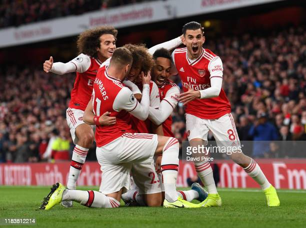 David Luiz celebrates scoring Arsenal's 2nd goal with PierreEmerick Aubameyang Dani Ceballos and Matteo Guendouzi during the Premier League match...