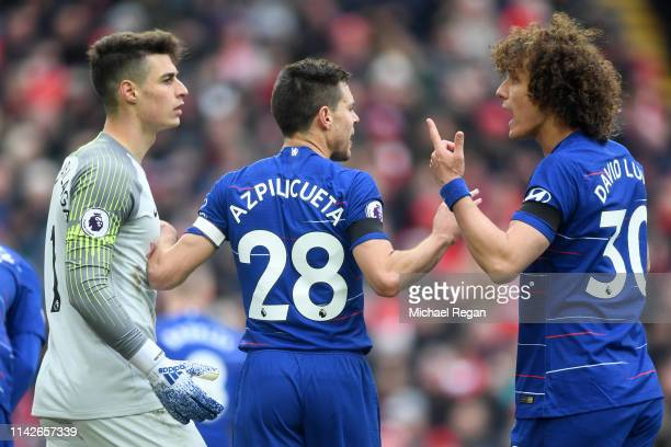 David Luiz Cesar Azpilicueta and Kepa Arrizabalaga of Chelsea in discussion during the Premier League match between Liverpool FC and Chelsea FC at...