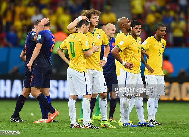 David Luiz consoles Oscar of Brazil as Hulk and Fernandinho of Brazil look on after a 30 defeat to the Netherlands during the 2014 FIFA World Cup...