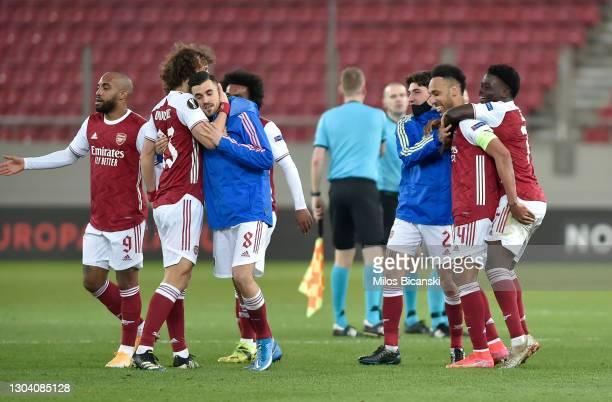 David Luiz, Dani Ceballos, Hector Bellerin, Pierre-Emerick Aubameyang, and Bukayo Saka of Arsenal celebrate following their team's victory in the...