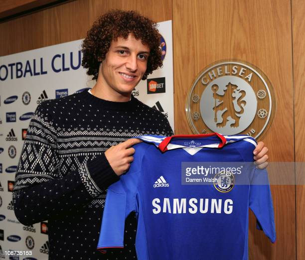 COVERAGE*** David Luiz holds a Chelsea shirt after signing for Chelsea FC at the Cobham training ground on February 2 2011 in Cobham England