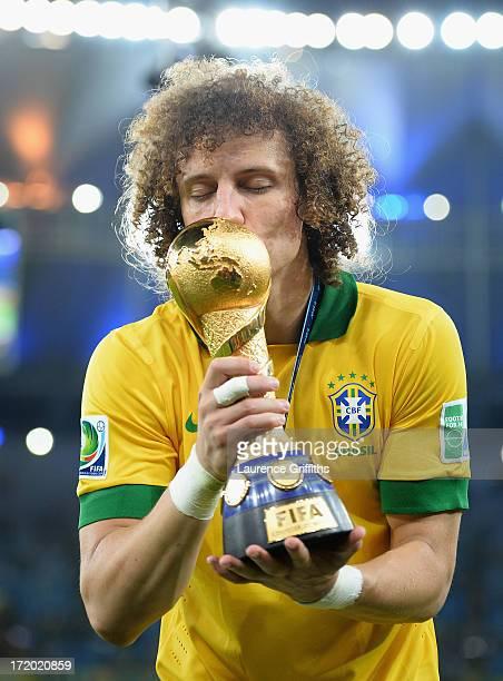 David Luiz kisses the FIFA Confederations Cup trophy after the FIFA Confederations Cup Brazil 2013 Final match between Brazil and Spain at Maracana...