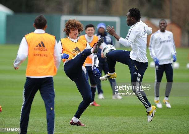 David Luiz, Michael Essien of Chelsea during a training session at the Cobham Training Ground on April 1, 2011 in Cobham, England.