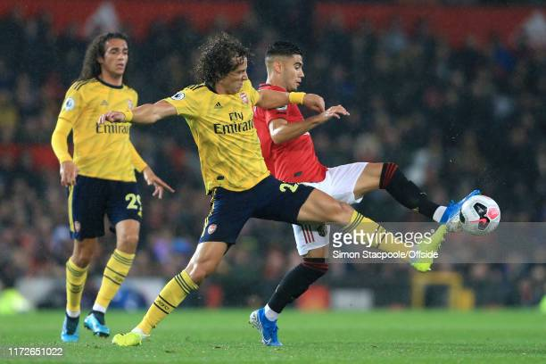 David Luiz of Arsenal and Andreas Pereira of Man Utd stretch for the ball during the Premier League match between Manchester United and Arsenal FC at...