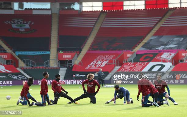 David Luiz of Arsenal and his team mates warm up prior to The Emirates FA Cup Fourth Round match between Southampton FC and Arsenal FC on January 23,...