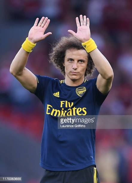 David Luiz of Arsenal apologises to the fans following their sides defeat during the Premier League match between Liverpool FC and Arsenal FC at...
