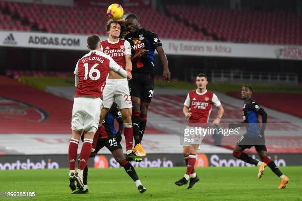 David Luiz of Arsenal battles for possession with Christian Benteke of Crystal Palace during the Premier League match between Arsenal and Crystal...