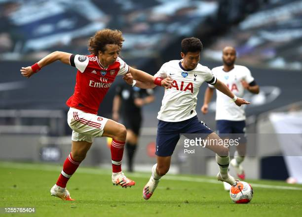 David Luiz of Arsenal battles for possession with Heung-Min Son of Tottenham Hotspur during the Premier League match between Tottenham Hotspur and...