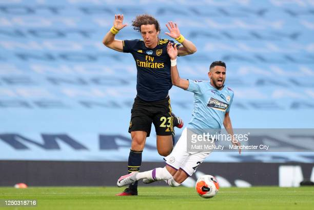 David Luiz of Arsenal battles for possession with with Riyad Mahrez of Manchester City which leads to a penalty for Manchester City and a red card...