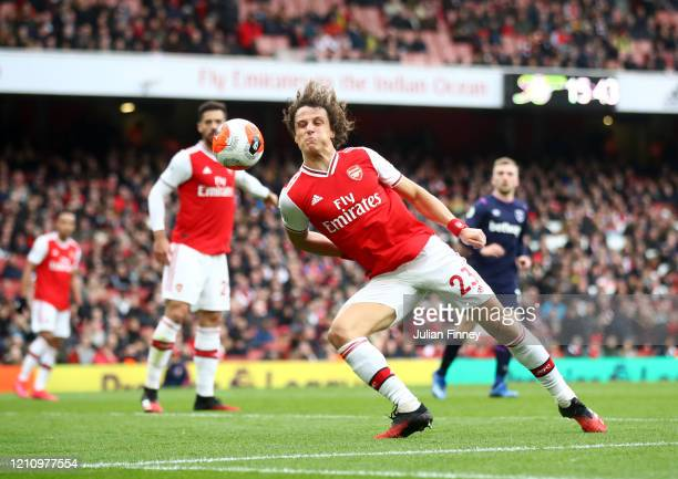 David Luiz of Arsenal blocks a cross during the Premier League match between Arsenal FC and West Ham United at Emirates Stadium on March 07, 2020 in...