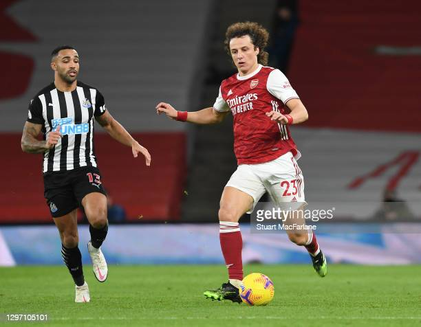 David Luiz of Arsenal breaks past Callum Wilson of Newcastle during the Premier League match between Arsenal and Newcastle United at Emirates Stadium...