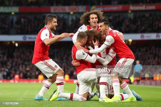 David Luiz of Arsenal celebrates with team mates after scoring his team's second goal during the Premier League match between Arsenal FC and Crystal...