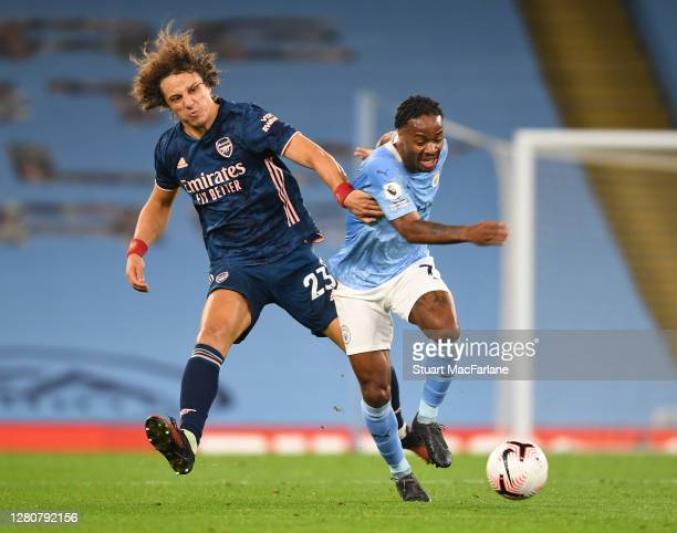 David Luiz of Arsenal challenges Raheem Sterling of Man City during the Premier League match between Manchester City and Arsenal at Etihad Stadium on...