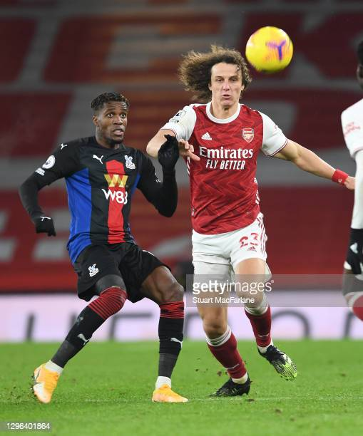 David Luiz of Arsenal challenges Wilfred Zaha of Crystal Palace during the Premier League match between Arsenal and Crystal Palace at Emirates...
