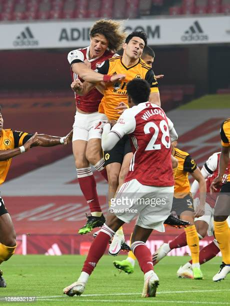 David Luiz of Arsenal clashes heads with Raul Jimenez of Wolves during the Premier League match between Arsenal and Wolverhampton Wanderers at...