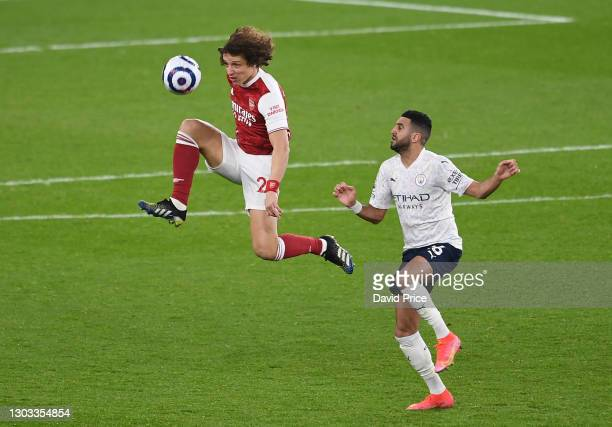 David Luiz of Arsenal clears the ball under pressure from Riyad Mahrez of Man City during the Premier League match between Arsenal and Manchester...