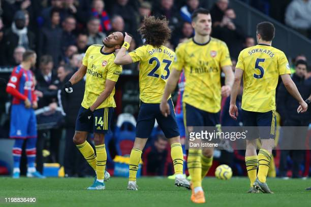 David Luiz of Arsenal consoles PierreEmerick Aubameyang of Arsenal after he receives a red card following a VAR decision during the Premier League...