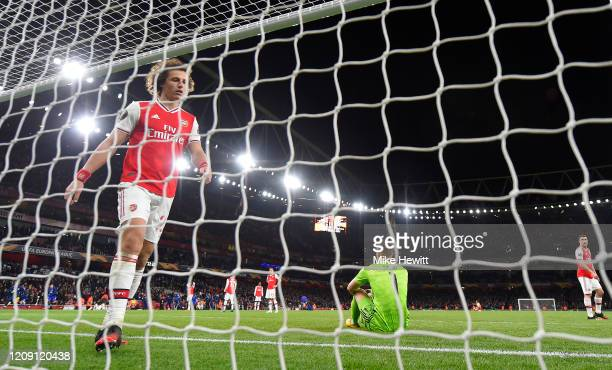 David Luiz of Arsenal FC and Bernd Leno of Arsenal FC react aftter their side concede their second goal during the UEFA Europa League round of 32...