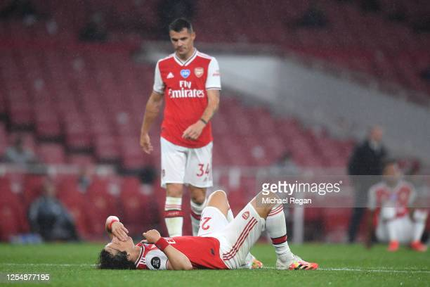 David Luiz of Arsenal goes down injured during the Premier League match between Arsenal FC and Leicester City at Emirates Stadium on July 07 2020 in...