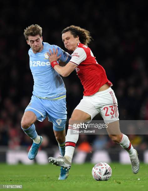 David Luiz of Arsenal holds off Patrick Bamford of Leeds United during the FA Cup Third Round match between Arsenal FC and Leeds United at the...
