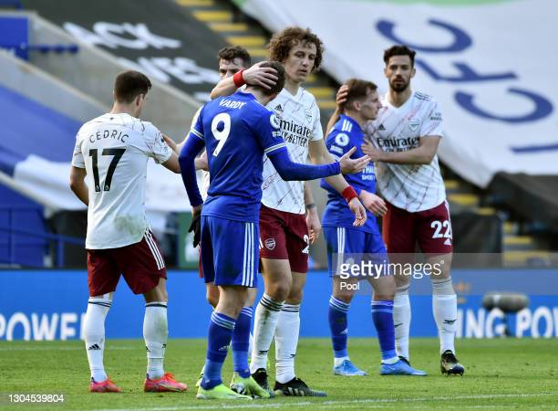 David Luiz of Arsenal interacts with Jamie Vardy of Leicester City following the Premier League match between Leicester City and Arsenal at The King...