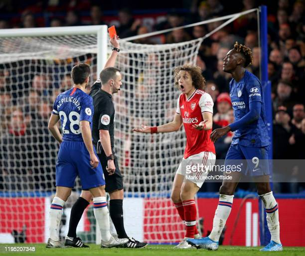 David Luiz of Arsenal is shown the red card by referee Stuart Attwell during the Premier League match between Chelsea FC and Arsenal FC at Stamford...