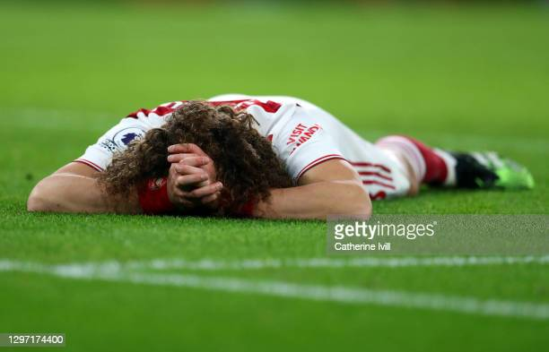 David Luiz of Arsenal lies on the pitch during the Premier League match between Arsenal and Newcastle United at Emirates Stadium on January 18, 2021...
