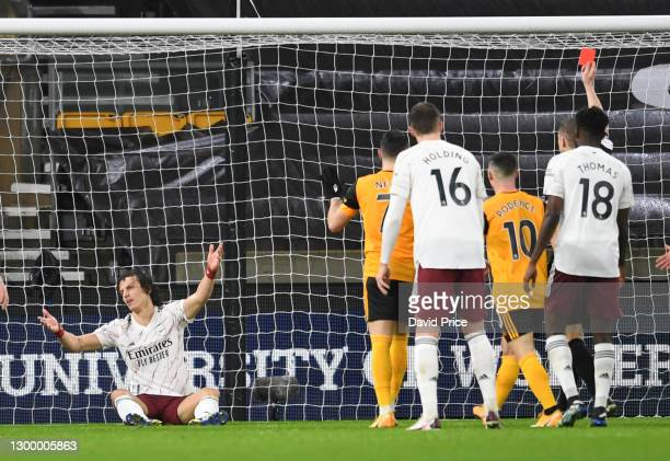 David Luiz of Arsenal reacts to being shown the red card during the Premier League match between Wolverhampton Wanderers and Arsenal at Molineux on...