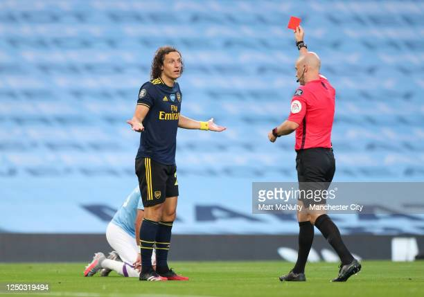 David Luiz of Arsenal receives a red card from match referee Anthony Taylor during the Premier League match between Manchester City and Arsenal FC at...