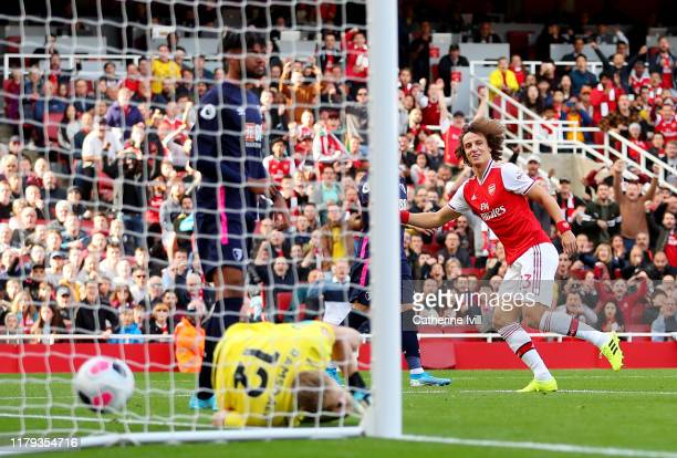 David Luiz of Arsenal scores his team's first goal during the Premier League match between Arsenal FC and AFC Bournemouth at Emirates Stadium on...