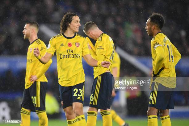 David Luiz of Arsenal speaks to team mate Pierre-Emerick Aubameyang during the Premier League match between Leicester City and Arsenal FC at The King...