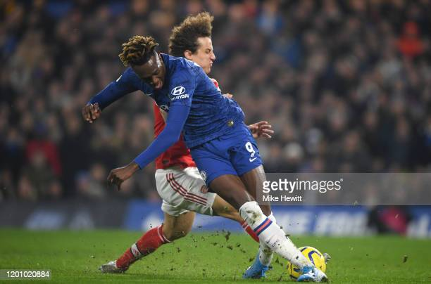 David Luiz of Arsenal tackles Tammy Abraham of Chelsea which is later awarded as a penalty during the Premier League match between Chelsea FC and...
