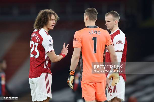 David Luiz of Arsenal talks to Arsenal goalkeeper Bernd Leno and Rob Holding of Arsenal before the Premier League match between Arsenal and Crystal...