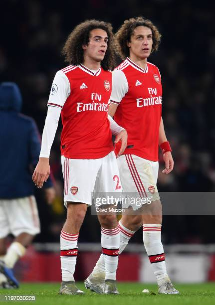 David Luiz of Arsenal talks with team mate Matteo Guendouzi of Arsenal after the Premier League match between Arsenal FC and Manchester United at...