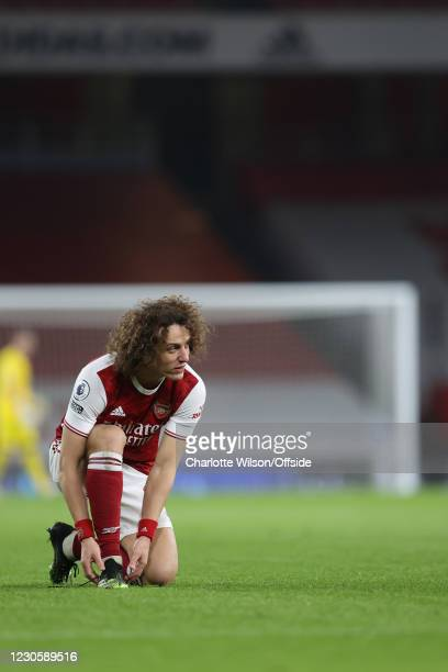 David Luiz of Arsenal ties his laces during the Premier League match between Arsenal and Crystal Palace at Emirates Stadium on January 14, 2021 in...