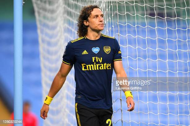 David Luiz of Arsenal walks along the touchline after being sent off during the Premier League match between Manchester City and Arsenal FC at Etihad...