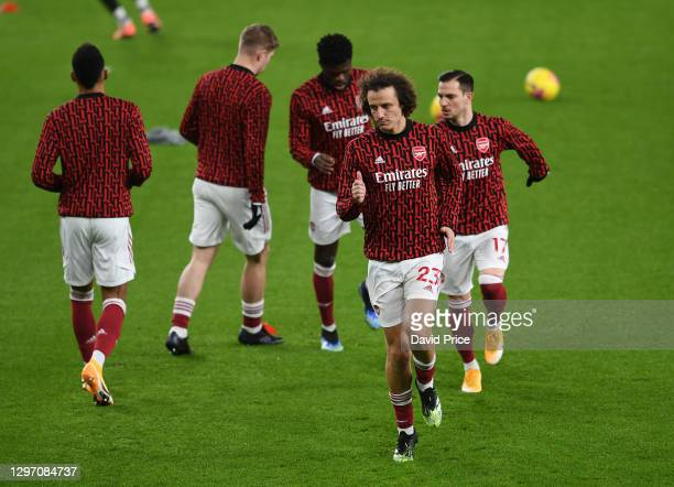 David Luiz of Arsenal warms up before the Premier League match between Arsenal and Newcastle United at Emirates Stadium on January 18, 2021 in...