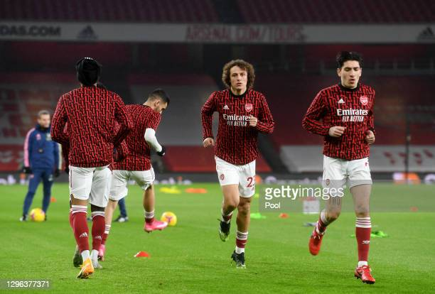 David Luiz of Arsenal warms up with teammates prior to the Premier League match between Arsenal and Crystal Palace at Emirates Stadium on January 14,...