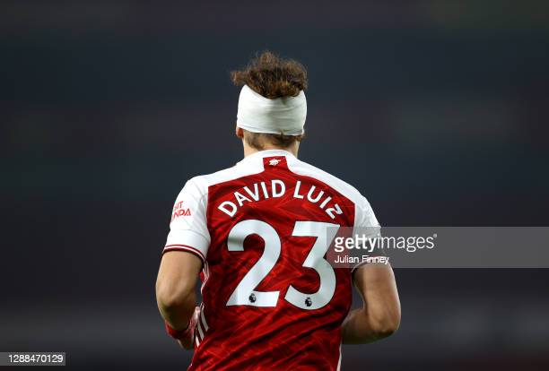 David Luiz of Arsenal wears a bandage after a colliding with Raul Jimenez of Wolverhampton Wanderers during the Premier League match between Arsenal...
