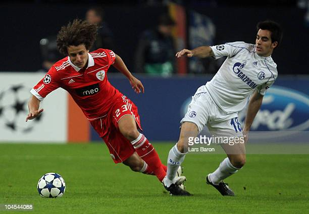 David Luiz of Benfica is challenged by Jurado of Schalke during the UEFA Champions League match between FC Schalke 04 and SL Benfica at Veltins Arena...